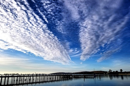Clouds over dock in Bodega Bay