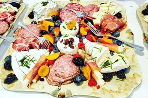 Party plater with salami, cheese and fruit